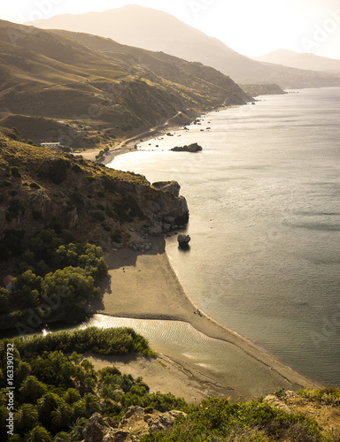 aerial view of the cretan beach at the sunset