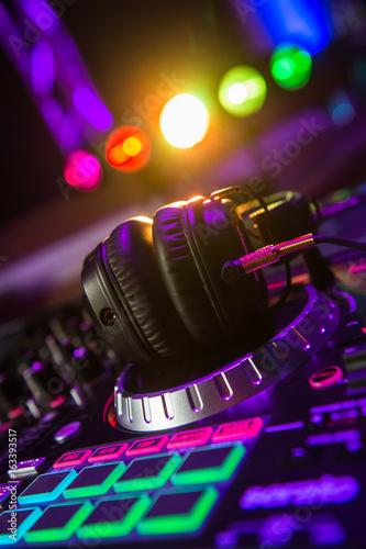 Dj mixer with headphones at a nightclub - 163393517