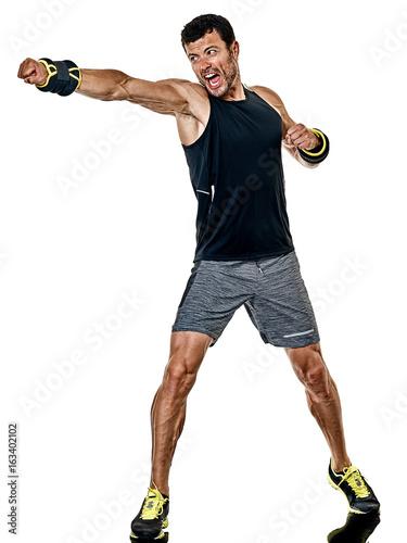 Fototapeta one caucasian fitness man exercising cardio boxing exercises in studio  isolated on white background