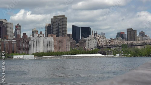 Foto op Aluminium New York Viewing beautiful breathtaking Manhattan Skyline from Long Island City in New York, wide shot panorama with ONU,United Nations Headquarters,Ultra Hd 4k, real time