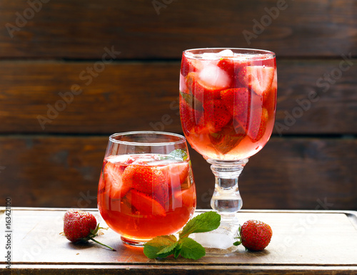 Homemade summer strawberry drink with mint and ice