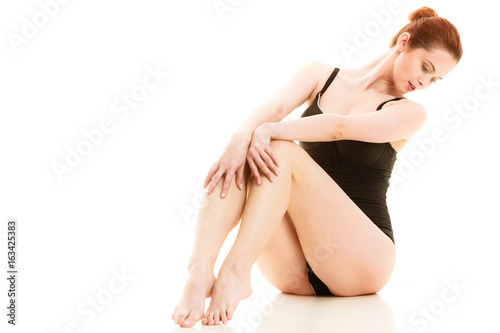 Sitting woman in underwear showing smooth legs Poster