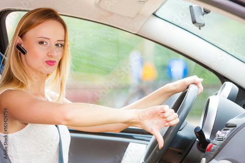 woman driving car annoyed by heavy traffic