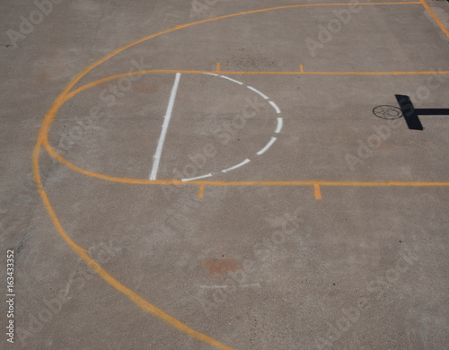 View of a part of a basketball court from above with shadow of the net