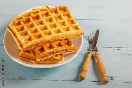 Freshly baked belgium waffles in plate. Breakfast concept