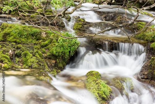 Foto op Aluminium Bos rivier Crystalline water games. Fontanon of Goriuda. Chiusaforte, Friuli