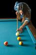 young woman shooting pool