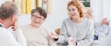 Senior women talking to man
