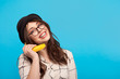 Cheerful woman using banana as phone