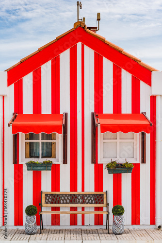 Typical small wooden houses with colorful stripes in Costa Nova. Aveiro. Portugal.