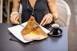 Traditional french pancake called galette cooked with buckweat and stuffed with cheese egg and ham on the restaurant table with coffee - 163476381