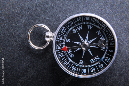 Plagát Classic compass isolated on black background