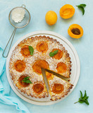 Biscuit cake with apricots and almonds. - 163527979