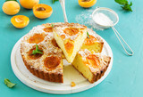 Biscuit cake with apricots and almonds. - 163528337