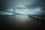 vasco da gama bridge in lisbon on a cloudy day