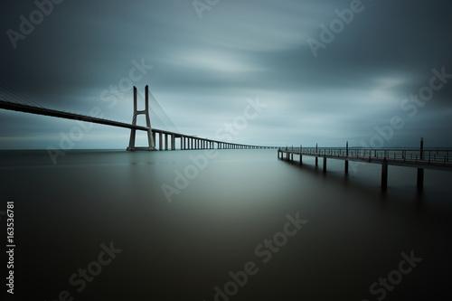 vasco da gama bridge in lisbon on a cloudy day