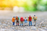 Miniature people, travelers with backpack walking to destination using as travel businees concept