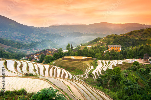 Fotobehang Rijstvelden Sunset over terraced rice field in Longji, Guilin in China
