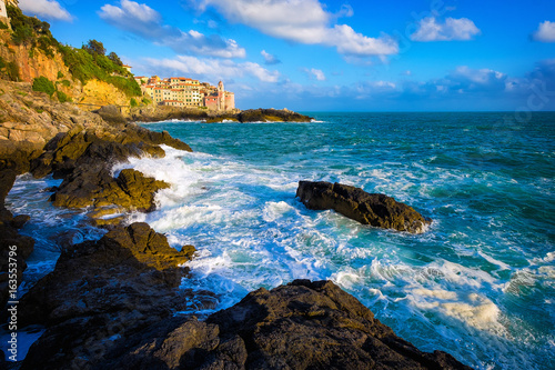 Tellaro rocks and old village on the sea. Church and houses. Five lands, Cinque Terre, Liguria Italy Europe.