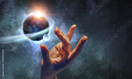 Foto Murales Touching planet with finger