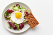 Isolated plate with healthy breakfast containing fried egg, lettuce and crispbread - 163559961