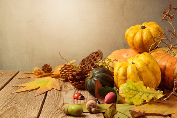 Autumn background with fall leaves and pumpkin on wooden table