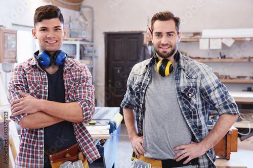 Deurstickers Two handsome young carpenters in workshop