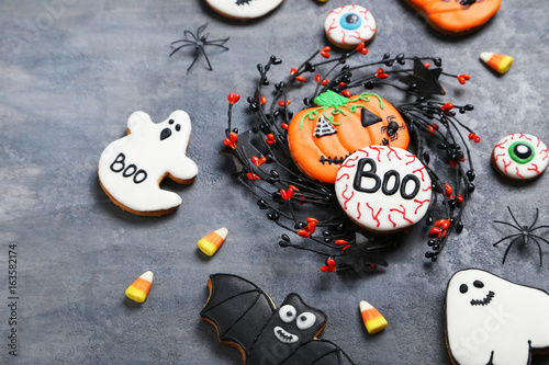 Fresh halloween gingerbread cookies on grey wooden table