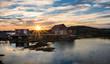 Sunrise over fishing stages on changeIslands,Change Islands, Newfoundland & Labrador