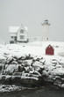 Maine lighthouse shines during snowstorm.