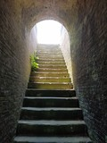 very old stairs and light at the end