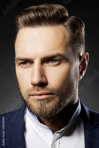 Close Up Portrait Of Handsome Young Man With Modern Fashion Hair
