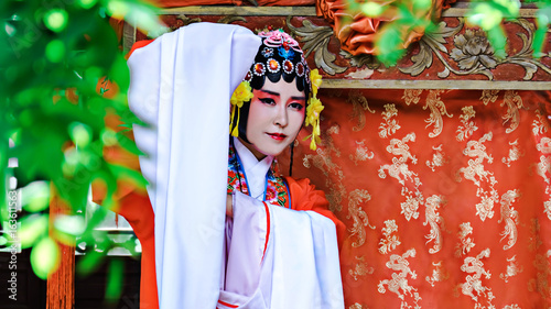 Chinese Woman Wearing Traditional Clothing in chinese park.