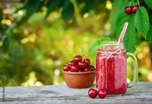 mason jar with cherry smoothie