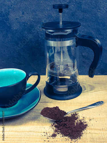 Ground coffee on the wooden background.