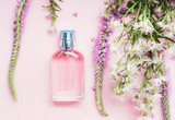 Floral perfume bottle with fresh herbs and flowers on pink background, top view.  Beauty concept - 163625587