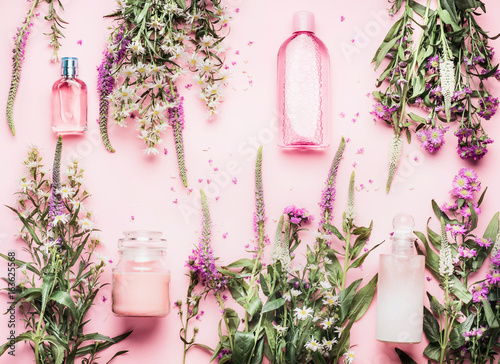 Natural cosmetic products setting with various bottles and fresh herbs and flowers on pink background, top view, flat lay. Beauty, skin, hair or body care concept - 163625568