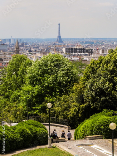 Cityscape of Paris with the Eiffel Tower in the background Photo by Helissa