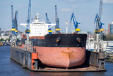 bulk carrier in floating dock for maintenance - 163641580