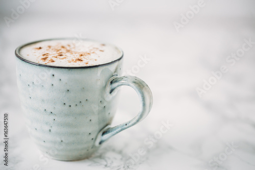Papiers peints Chocolat Cappuccino in a rustic style mug on a marble table