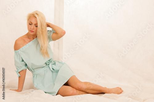 Boudoir photos of a beautiful blond woman in night dress
