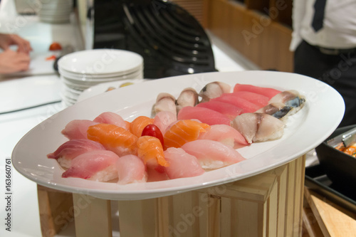 sushi and maki roll on wood