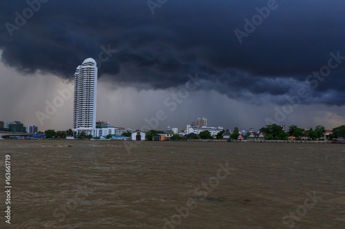 Dark cloud storm in the city near the river / Rain coming on the sky in the city view