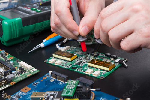 Electronic circuit board inspecting close up
