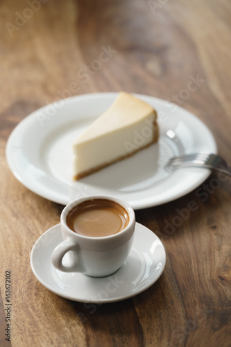 fresh espresso and cheesecake on table Poster