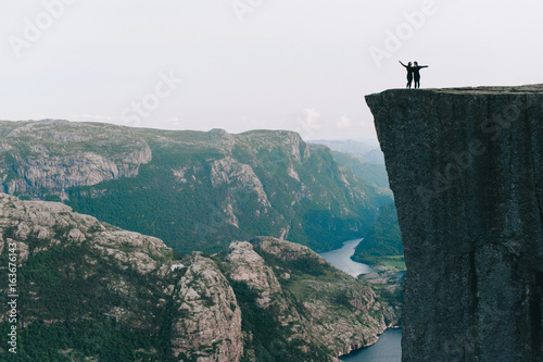 Girls standing on the edge of Preykestalen, Norway