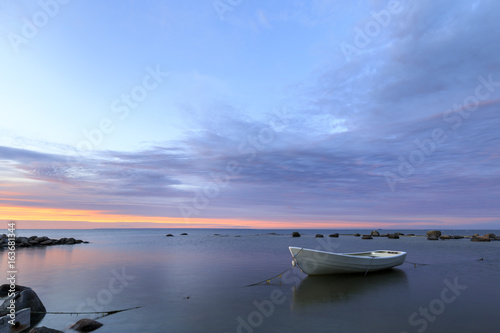 Poster White boat in sea at sunset