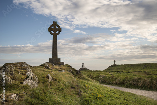 Stunning Summer landscape image of lighthouse on end of headland with beautiful sky