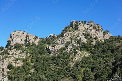 The ruins of the castle of Ultrera at the top of a steep rocky spur of the Massif des Alberes, Pyrenees Orientales, Roussillon, south of France