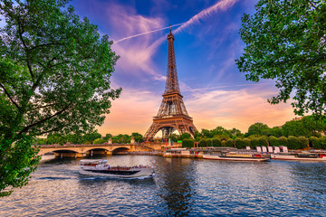 Paris Eiffel Tower and river Seine at sunset in Paris, France. Eiffel Tower is one of the most iconic landmarks of Paris.